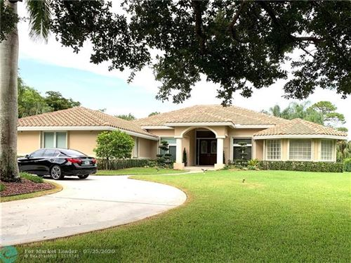 Photo of 6310 NW 72nd Way, Parkland, FL 33067 (MLS # F10237111)