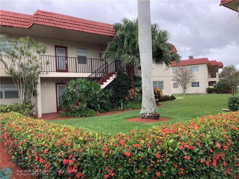 Photo of 32 Abbey Ln #208, Delray Beach, FL 33446 (MLS # F10284112)