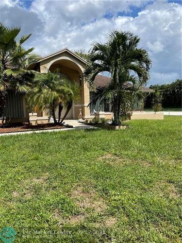 Photo of 11035 66th St, West Palm Beach, FL 33412 (MLS # F10301116)