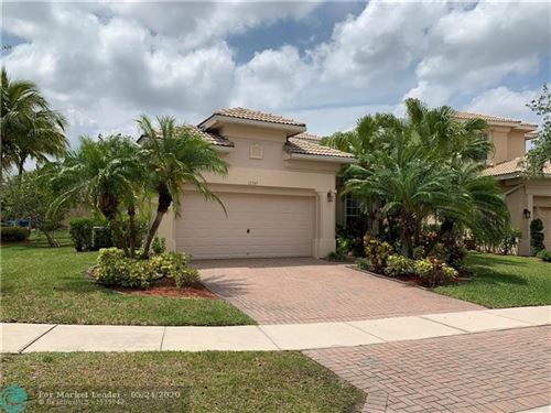 Photo of 12349 NW 77th Mnr, Parkland, FL 33076 (MLS # F10230128)