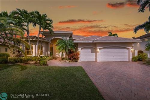 Photo of 10221 Key Plum St, Plantation, FL 33324 (MLS # F10267131)