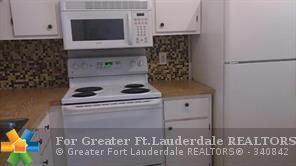 Photo of 1248 S Military Trl, Deerfield Beach, FL 33442 (MLS # F10105135)