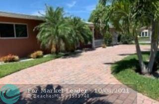 Photo of 2182 NE 59th Ct, Fort Lauderdale, FL 33308 (MLS # F10302137)