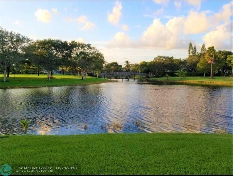 Photo of 9685 NW 61st Dr, Parkland, FL 33076 (MLS # F10256138)