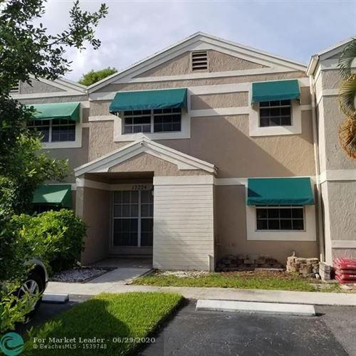 Photo of 12224 SW 52nd Pl, Cooper City, FL 33330 (MLS # F10236140)