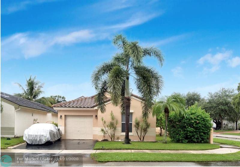 Photo of 18498 NW 21st St, Pembroke Pines, FL 33029 (MLS # F10250147)
