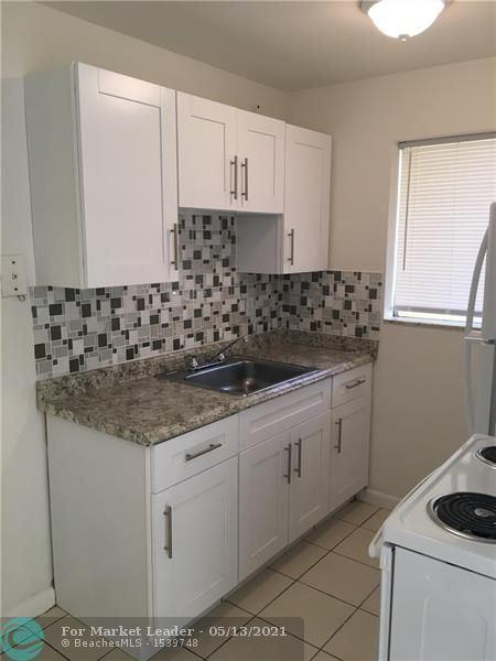 Photo of 16 SW 9th Street #103, Fort Lauderdale, FL 33315 (MLS # F10284147)