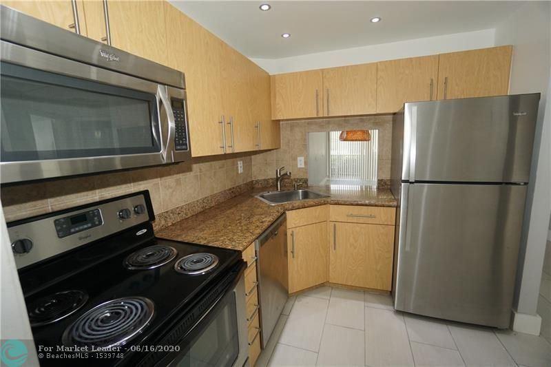 Photo of 4501 NE 21st Ave #112, Fort Lauderdale, FL 33308 (MLS # F10234152)