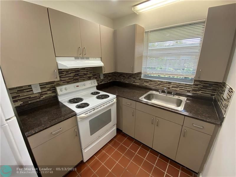 Photo of 400 Charley Ave #7, Fort Lauderdale, FL 33312 (MLS # F10284154)
