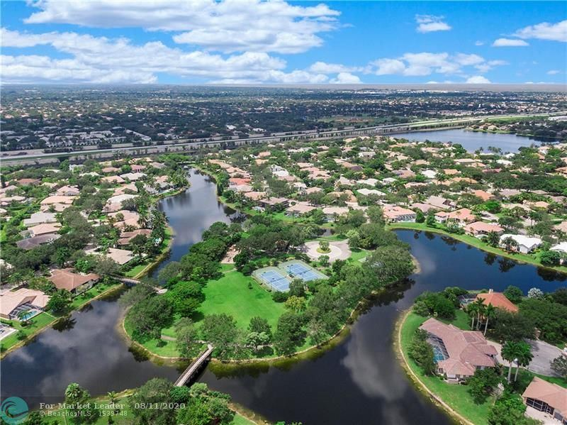 Photo of 6240 NW 96th Ter, Parkland, FL 33076 (MLS # F10243157)
