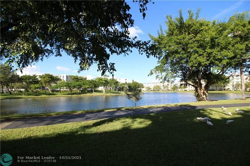Photo of 2209 S Cypress Bend Dr #104, Pompano Beach, FL 33069 (MLS # F10305160)