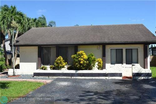 Photo of 8321 SW 41st St, Davie, FL 33328 (MLS # F10302170)