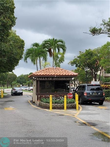 Photo of 6201 N Falls Circle Dr #305, Lauderhill, FL 33319 (MLS # F10258171)