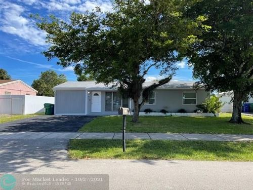 Photo of 1354 SW 50th Ave, Fort Lauderdale, FL 33317 (MLS # F10306177)