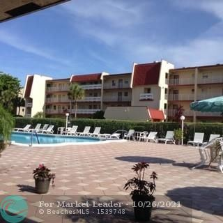 Photo of 1020 Country Club Dr #205, Margate, FL 33063 (MLS # F10305180)