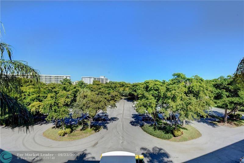 Photo of 4020 W Palm Aire Dr #208, Pompano Beach, FL 33069 (MLS # F10249184)
