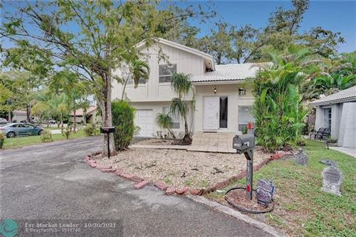 Photo of 1298 NW 91st Ave, Coral Springs, FL 33071 (MLS # F10305186)