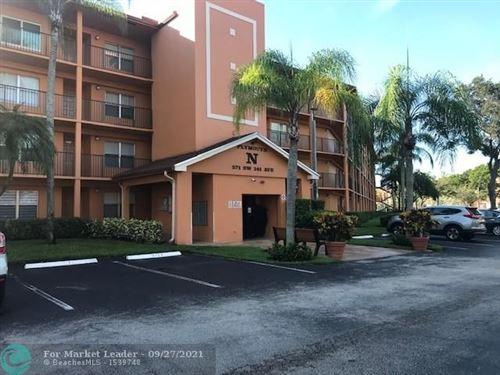 Photo of 571 SW 141st Ave #205N, Pembroke Pines, FL 33027 (MLS # F10302187)