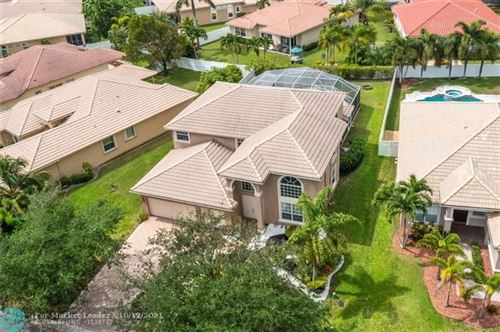 Photo of 5869 NW 56th Dr, Coral Springs, FL 33067 (MLS # F10304187)