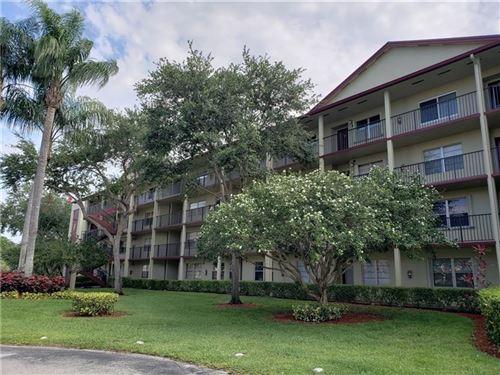 Photo of 701 SW 128th Ave #301, Pembroke Pines, FL 33027 (MLS # F10281192)