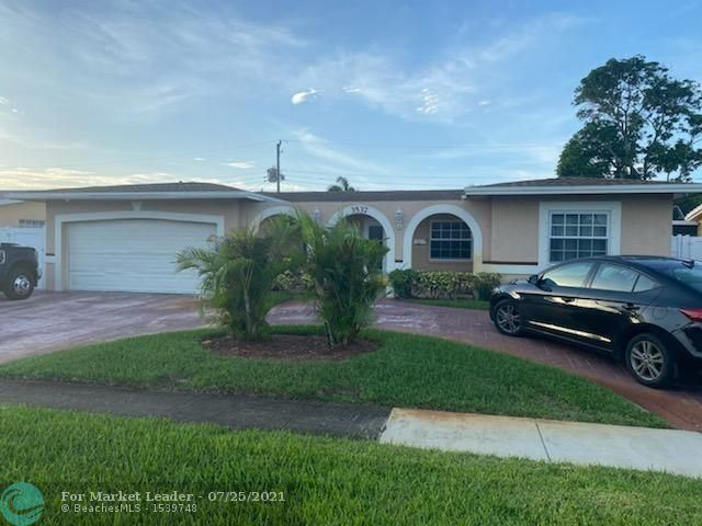 Photo of 3537 NW 24th St, Lauderdale Lakes, FL 33311 (MLS # F10294194)