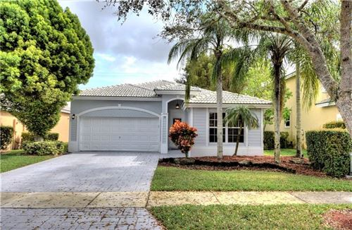 Photo of 7440 NW 70th Ave, Parkland, FL 33067 (MLS # F10271199)