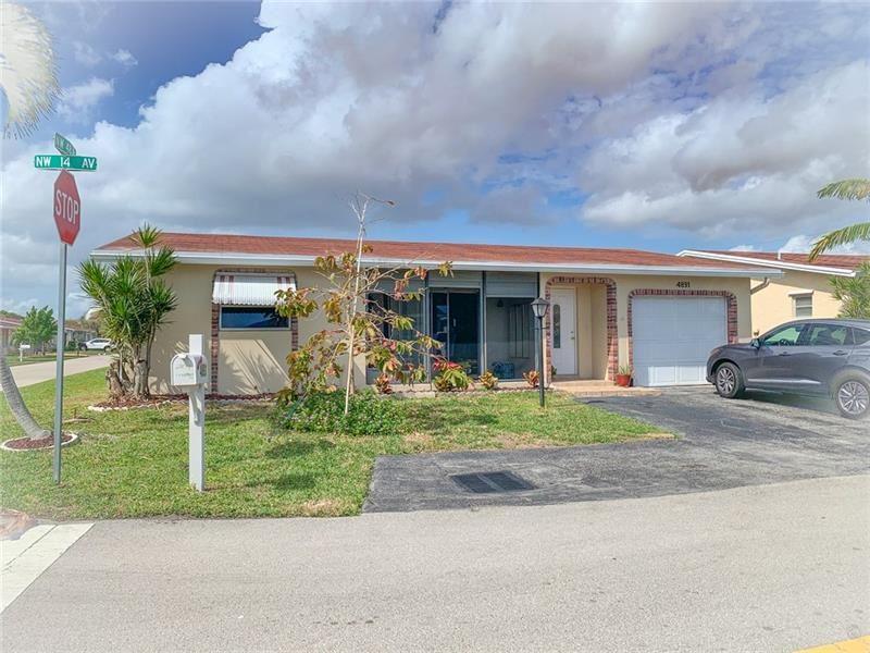 Photo of 4891 NW 14th Ave, Deerfield Beach, FL 33064 (MLS # F10271201)