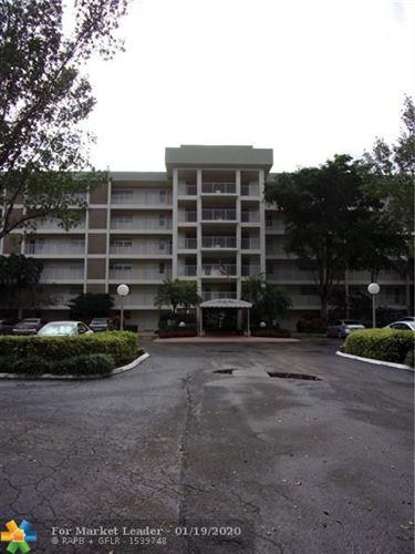 Photo of 3150 N Course Ln #106, Pompano Beach, FL 33069 (MLS # F10212203)