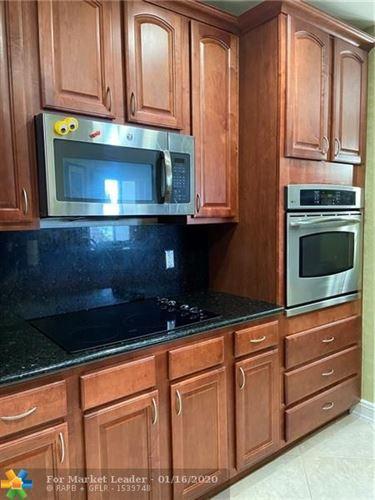Photo of 16102 Emerald Estates Dr #407, Weston, FL 33331 (MLS # F10211205)