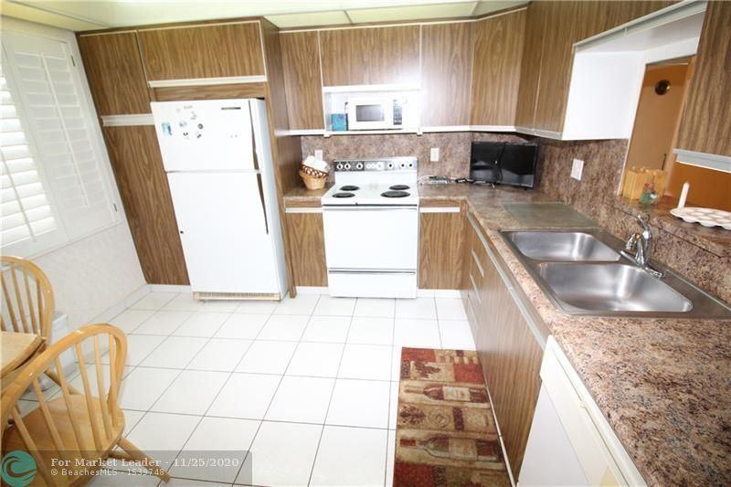 Photo of 2302 Lucaya Ln #J4, Coconut Creek, FL 33066 (MLS # F10260208)