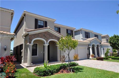 Photo of 692 NE 191st St, Miami, FL 33179 (MLS # F10298216)
