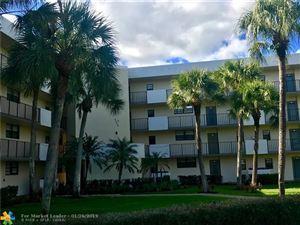 Photo of 2440 Deer Creek Country Club Blvd #106, Deerfield Beach, FL 33442 (MLS # F10153219)