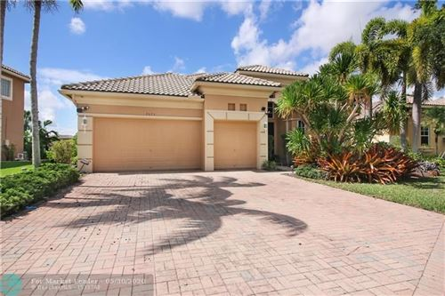 Photo of 7673 NW 122nd Dr, Parkland, FL 33076 (MLS # F10231219)