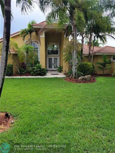 Photo of 6051 NW 60th Ave #6051, Parkland, FL 33067 (MLS # F10290221)