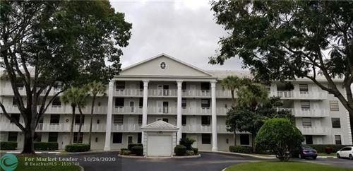 Photo of 1713 Whitehall Dr #103, Davie, FL 33324 (MLS # F10254223)