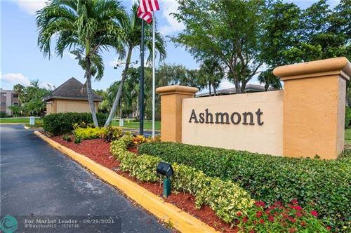 Photo of 7106 Ashmont Cir #102, Tamarac, FL 33321 (MLS # F10302223)