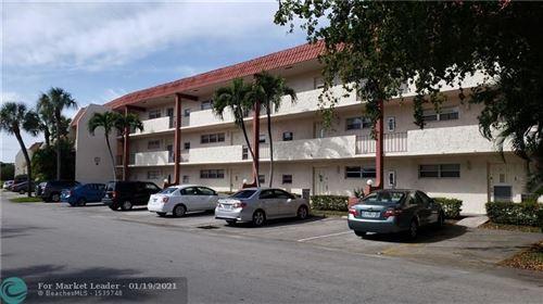 Photo of 671 S Hollybrook Dr #302, Pembroke Pines, FL 33025 (MLS # F10267230)