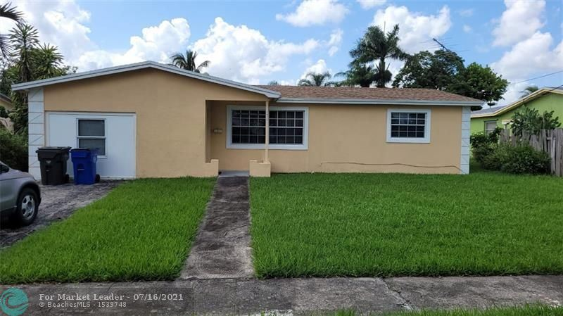 Photo of 3411 NW 40th St, Lauderdale Lakes, FL 33309 (MLS # F10293240)