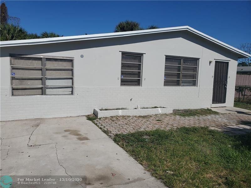 Photo of 1352 W 6th St, Riviera Beach, FL 33404 (MLS # F10259241)