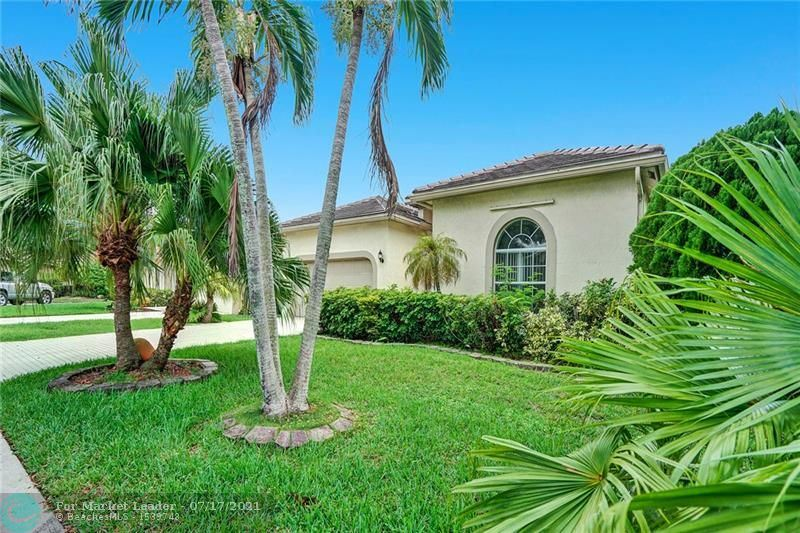 Photo of 5870 NW 72nd Court, Parkland, FL 33067 (MLS # F10293241)