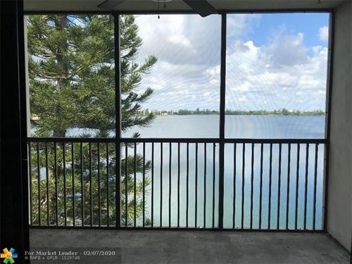 Photo of 111 Lake Emerald Dr #407, Oakland Park, FL 33309 (MLS # F10199243)