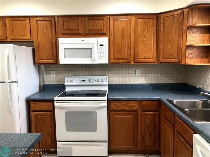 Photo of 6100 NW 44th St #210, Lauderhill, FL 33319 (MLS # F10248246)