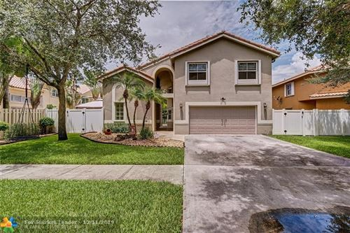 Photo of 6011 NW 57th Way, Parkland, FL 33067 (MLS # H10752247)