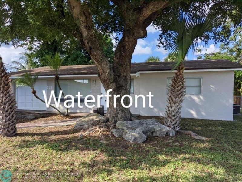 Photo of 521 NW 38th Pl, Deerfield Beach, FL 33064 (MLS # F10303251)