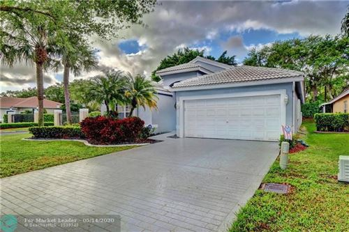 Photo of 6014 NW 75th Ct, Parkland, FL 33067 (MLS # F10222254)