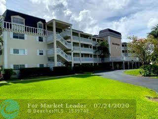 Photo of 3475 Broken Woods Dr #308, Coral Springs, FL 33065 (MLS # F10240258)