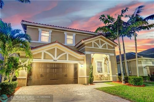 Photo of 8621 Waterside Ct, Parkland, FL 33076 (MLS # F10268260)