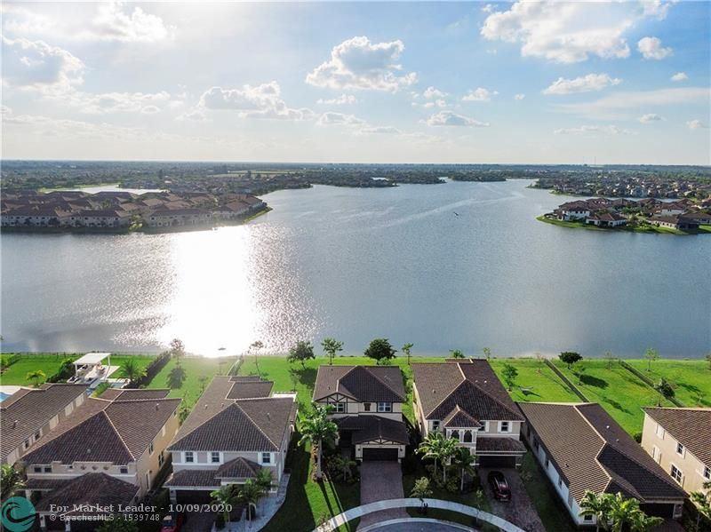 Photo of 8581 Miralago Way, Parkland, FL 33076 (MLS # F10246262)