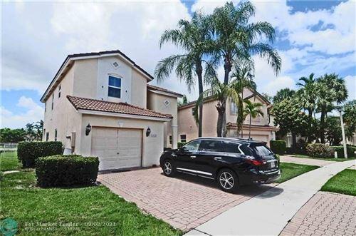 Photo of 1612 SW 159th Ave, Pembroke Pines, FL 33027 (MLS # F10299264)