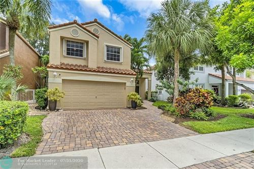 Photo of 6180 NW 77th Pl, Parkland, FL 33067 (MLS # F10241271)